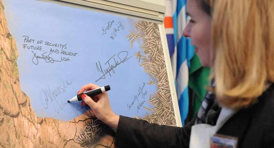 Ganna Vronska, Deputy Minister on EU Integration, Ministry of Ecology and Natural Resources of Ukraine, signed the poster during the Security Days event on climate change and security